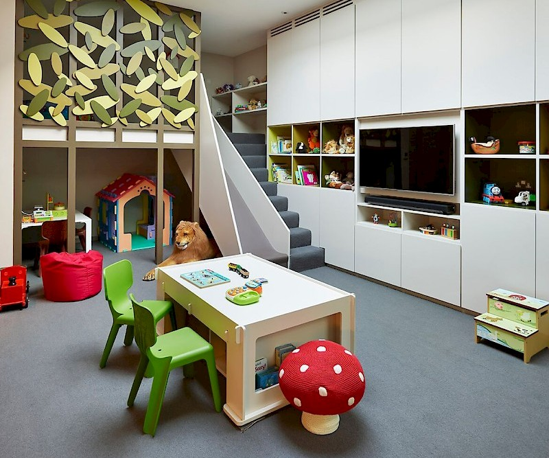 Amazing, dedicated kids space configured as a playroom for young and old alike
