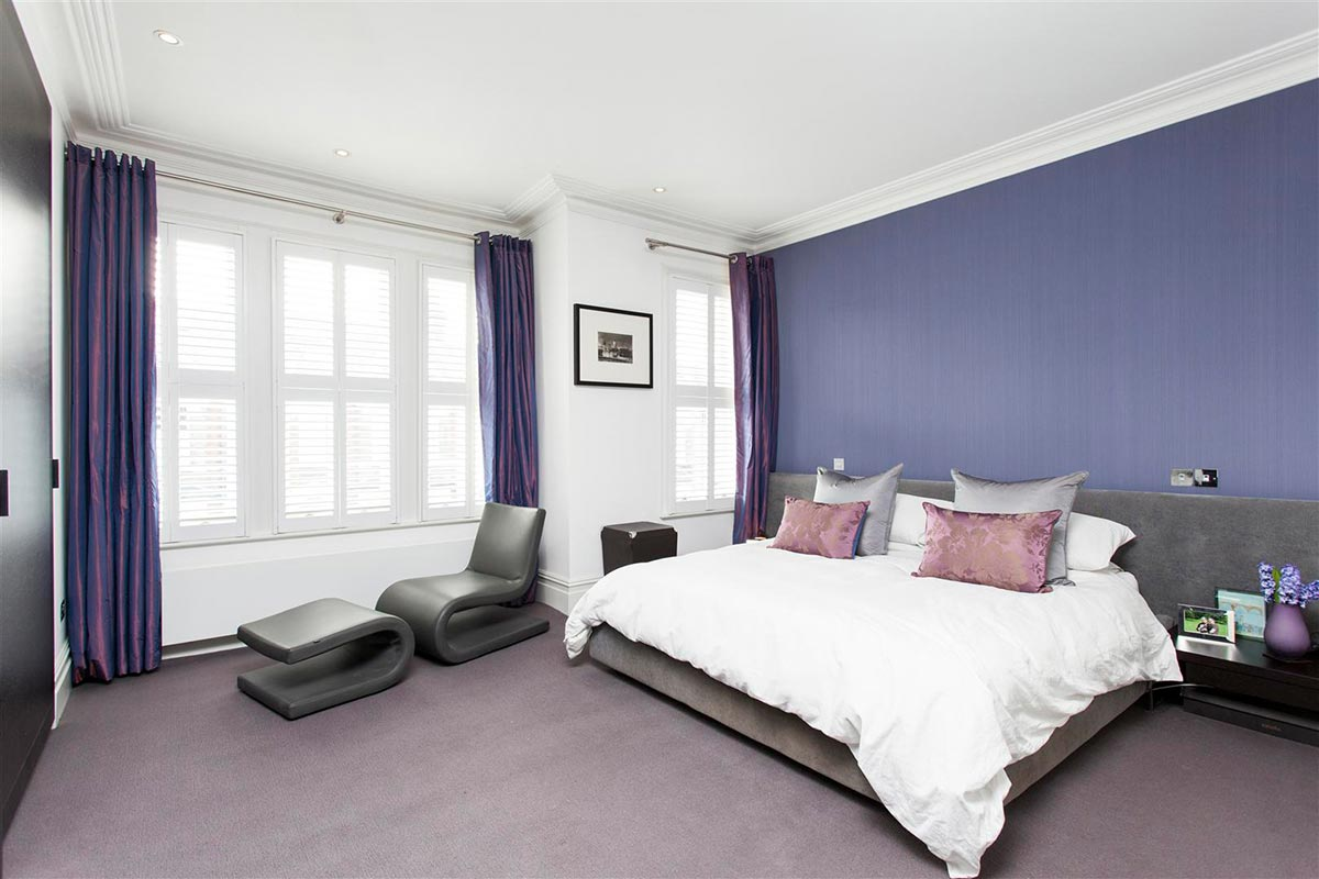 Ensoul Clapham Master Bedroom Purple Upholstered Bed Plantation shutters chaise