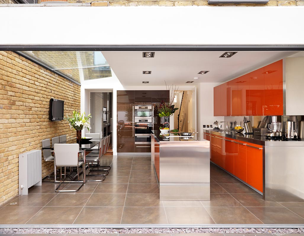 Ensoul Clapham Side Return Architecture Rear Extension Kitchen dining Stainless Steel Worktops Orange Exposed Brick