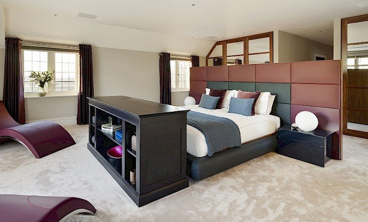 aster bedroom with bespoke statement leather panelled bed chaise