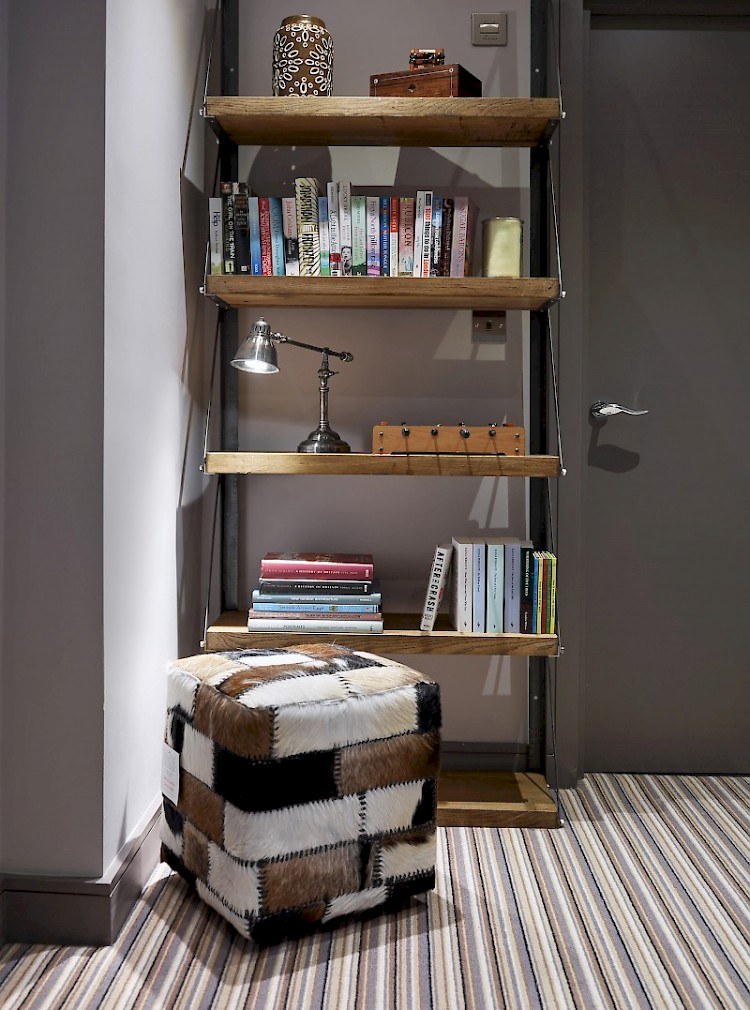 Industrial style reading nook hallway book shelf