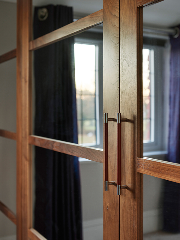 By Ensoul walnut and mirror bespoke wardrobes leather handle